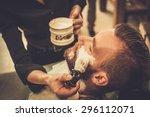 client during beard shaving in... | Shutterstock . vector #296112071
