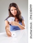 Small photo of Woman playing cards with ace of spades in her hand, isolated