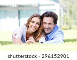 happy couple lying in front of... | Shutterstock . vector #296152901