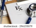 prescription form clipped to... | Shutterstock . vector #296155079