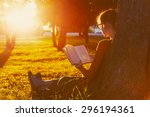girl reading book at park in... | Shutterstock . vector #296194361