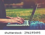 hands using laptop and typing... | Shutterstock . vector #296195495