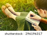 girl with pen writing on...   Shutterstock . vector #296196317