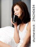 beautiful woman drinking coffee ... | Shutterstock . vector #296240654