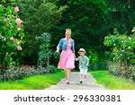 happy mother and son walking in ... | Shutterstock . vector #296330381