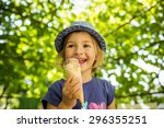happy little girl licking ice... | Shutterstock . vector #296355251