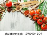 Tomatoes  Wooden Spoons With...