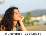 woman relaxing and enjoying the ... | Shutterstock . vector #296425169