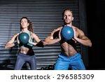 Muscular Couple Doing Ball...