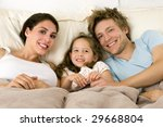 happy family laying in bed   Shutterstock . vector #29668804
