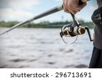 hand holding a fishing rod with ... | Shutterstock . vector #296713691