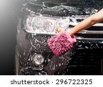 man washing a soapy black car... | Shutterstock . vector #296722325