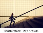 young girl walking up stairs in ... | Shutterstock . vector #296776931