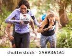 two women enjoying a run in a... | Shutterstock . vector #296936165