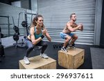muscular couple doing jumping... | Shutterstock . vector #296937611