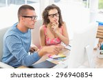 concentrated coworkers using... | Shutterstock . vector #296940854