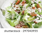 a house salad containing leafy...   Shutterstock . vector #297043955