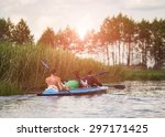 Young People Are Kayaking On A...