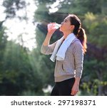 sporty woman drinking water... | Shutterstock . vector #297198371