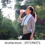 sporty woman drinking water... | Shutterstock . vector #297198371