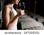 young woman in the wine cellar | Shutterstock . vector #297335531