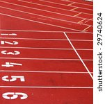 Tracks and numbers on an athletic field - stock photo