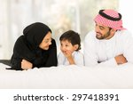 Happy Young Muslim Family Of...