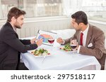 handsome businessman is sitting ... | Shutterstock . vector #297518117