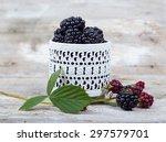 blackberries on a wooden table...   Shutterstock . vector #297579701