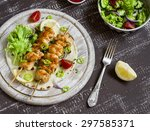 chicken kebabs and fresh... | Shutterstock . vector #297585371