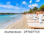 sunbeds on beautiful white sand ... | Shutterstock . vector #297607715