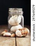 Garlic In Mason Jar On Black...