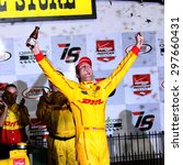 Newton, Iowa USA - July 18, 2015: Verizon IndyCar Series Iowa Corn Indy 300. Ryan Hunter-Reay wins at Iowa for the third time. Celebration as he gets out of the race car. - stock photo