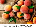 Ripe Peaches In Basket On...