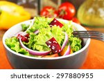 bowl of fresh green salad on... | Shutterstock . vector #297880955