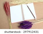 notebook and a bouquet flowers - stock photo