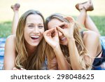 two female friends enjoying... | Shutterstock . vector #298048625