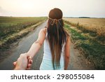 young woman leading man | Shutterstock . vector #298055084
