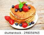 pancakes with fresh berries | Shutterstock . vector #298056965