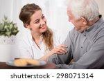 Young Volunteer Visiting Elder...