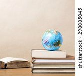 book and earth ball on wood... | Shutterstock . vector #298085045