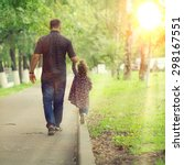 dad walks with her daughter in... | Shutterstock . vector #298167551