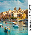 Small photo of beautiful view on Birgu and the harbour with colorful boats in Malta