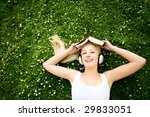 woman lying on grass with book... | Shutterstock . vector #29833051