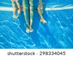 3 pairs of feet under water in... | Shutterstock . vector #298334045