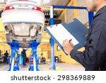 mechanic recording a clipboard... | Shutterstock . vector #298369889