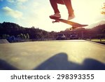 skateboarder legs doing a trick ... | Shutterstock . vector #298393355