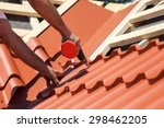 worker on a roof with electric... | Shutterstock . vector #298462205
