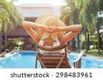 Stock photo woman relaxing in luxury hotel summer holidays 298483961
