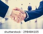 handshake of businessmen on...